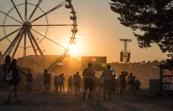 The sun sets over the Pol'and'Rock ferris wheel. Photo credit: Lucyna Lewandowska